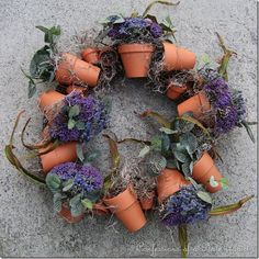 Lavender terra-cotta pot wreath :: DIY instructions using a grapevine wreath, twine, assorted terra cotta pots, floral foam AND lavender. Perfect for summer.