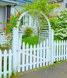 Gallery of beautiful arbor designs for a variety of backyard gardens. See different types and get garden arbor ideas to create a backyard you'll love. Garden Arches, Garden Entrance, Garden Gates, Picket Fence Gate, White Picket Fence, Front Yard Fence, Front Yard Landscaping, Backyard Walkway, Country Fences