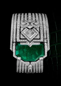 Cartier Secret Watch made of White Gold, Emeralds, and Diamonds.