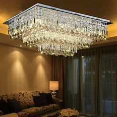 Then place newspaper on a flat surface and begin removing your crystals. Try to arrange them in the right order on the newspaper to make re-hanging them easier. Chandelier Lighting Fixtures, Stair Lighting, Ceiling Fixtures, Pendant Lighting, Crystal Ceiling Light, Led Ceiling Lamp, Crystal Wall, Crystal Chandeliers, Led Lamp