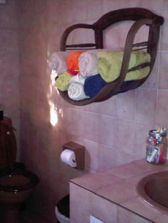 Upcycled Towel Rack made from an old wooden captain's chair.