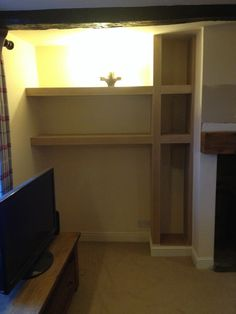 This is a alcove unit for log storage on right to fit around existing TV
