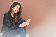 young beautiful woman happy with her phone talking and texting a
