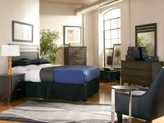 The Dakota Skyline Queen Bedroom has a contemporary style and balanced design.