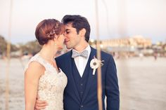 adorable couple alert. See their seaside wedding here: http://www.stylemepretty.com/florida-weddings/2012/07/24/st-pete-beach-wedding-at-the-postcard-inn-by-lauren-piper-photography/  Photography by laurenpiper.com