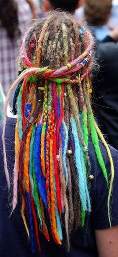 multi coloured hair in dreadlocks de colores by davekpcv, via Flickr  I don't know that I'd dig this on the pillow next to mine, but I sure LOVE the idea of it!
