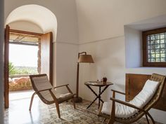 Vacation Dreaming: Elegant Simplicity on the Italian Island of Pantelleria (Remodelista: Sourcebook for the Considered Home) Tidy Kitchen, Summer Kitchen, Rustic Stone, Thatched Roof, Soothing Colors, Indoor Outdoor Living, Story House, Elegant Homes, Luxury Villa