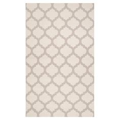 Showcasing a quatrefoil-inspired trellis motif, this artfully hand-woven wool rug adds Eastern-inspired appeal to your living room or study.