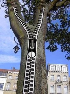 A painting of a zipper onto a tree. Street art can be found everywhere and created out of nearly anything.