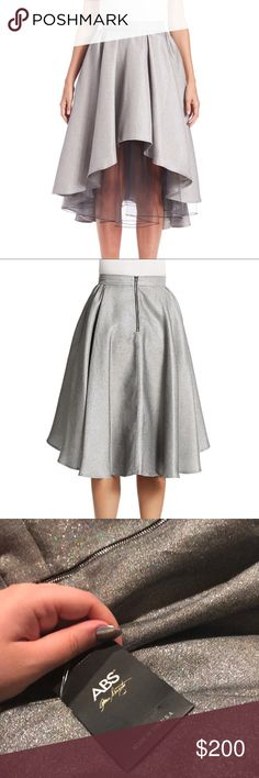 ABS Silver Hi-Lo Skirt Brand new skirt size 2... it's a cute silver with tulle layering on the inside! Perfect for New Years and the holidays! Has an exposed zipper on the back for an extra flare! ABS Allen Schwartz Skirts High Low