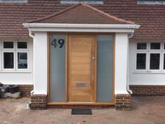 Oak front door with sidelights manufactured by Medina Joinery Brick Porch, Porch Windows, House Front Porch, Front Porch Design, House Entrance, Porch Uk, Porch Doors, Porch Area, Oak Front Door