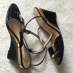 Black Wedge Sandals In good condition, however missing the rubber clasp in the back of he ankle strap (last picture). However, you can wrap the ankle straps which ever way you want. Usual wear on soles and small scratches on wedge part and toe area. Monet Shoes Wedges