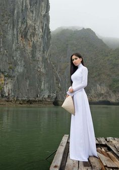 Ao dai trang - A beautifully simple traditional Vietnamese long dress worn with dress pants