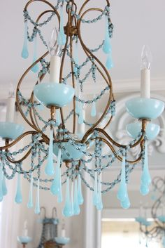 Gorgeous blue opaline Murano glass drops and beaded garland are strung from this 1930's chandelier from Italy.