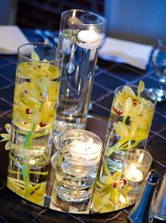 Gorgeous Cymbidium Orchid and floating Candle Centerpieces for very elegant Wedding decor, by Flowers of Charlotte