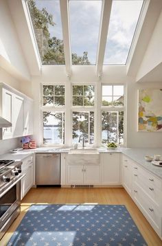Oh how I would love to have window like this in my kitchen!!!