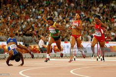 Danielle Williams of Jamaica crosses the finish line to win gold in the Women's 100 metres hurdles final as Tiffany Porter of Great Britain (L) falls during day seven of the 15th IAAF World Athletics Championships Beijing 2015 at Beijing National Stadium on August 28, 2015 in Beijing, China.