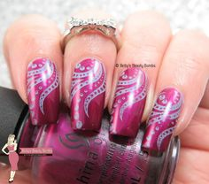 Purple and blue stamping nail art