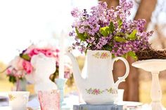 DIY Tea Pot Centerpieces Ruffled featured this beautiful vintage bridal shower that took place outdoors. Re-create these DIY centerpieces using tea pots and placing flowers inside. Sit them on top of a few old books, and this centerpiece will fit in perfectly with a vintage theme.