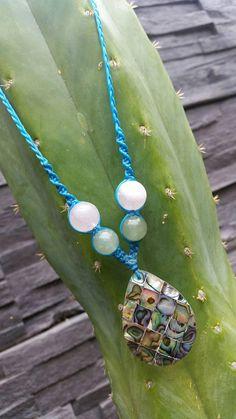 Abalone teardrop shaped shell pendant made into an adjustable necklace with gemstone and wood beads. Can CUSTOM MAKE to any cord colour-------------------------------------------------------------- #abalone #shell #pendant #teardrop #necklace #macrame #art #jewelrymaking #etsyjewelry #spiritualjewelry #spiritualhealing #crystalhealing #gifts #giftideas #sacred #spiritual #spiral
