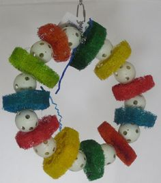 HB0135 Louffa Ring $27.95 The Louffa Ring is a great chewing toy. It has different colored louffas and wiffle balls connected together in a ring. It is held together by a metal piece and a chain that you can use to hang it with. Large Birds; 12x12