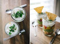 100 Clever Ways to Repurpose Mason Jars via Brit + Co. Moms guacamole with pico de gallo and sour cream