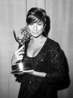 """Sultry Barbra Streisand with her Emmy for the TV special """"My Name is Barbra,"""" at the Hilton's Grand Ballroom in New York, 1965. Description from makers.com. I searched for this on bing.com/images"""