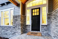 Home Renovation Front Door black front door stone work exterior - Not every project has to be big (or extremely expensive) to add value to your home. These done-in-a-weekend projects, for example, are high in return. Fiberglass Entry Doors, Black Front Doors, Balkon Design, House Front Door, Weekend Projects, Home Renovation, Home Values, Curb Appeal, Home Improvement