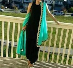 Full black dress with lovely attractive duptta of blueish green colour. Punjabi Dress, Pakistani Dresses, Indian Dresses, Anarkali Dress, Indian Suits, Indian Attire, Indian Wear, Designer Punjabi Suits, Indian Designer Outfits