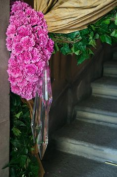 Pink carnations paired with crystals serve as curatin tie backs.