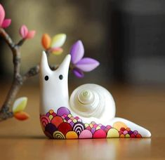 cute snail made with a real shell and clay.