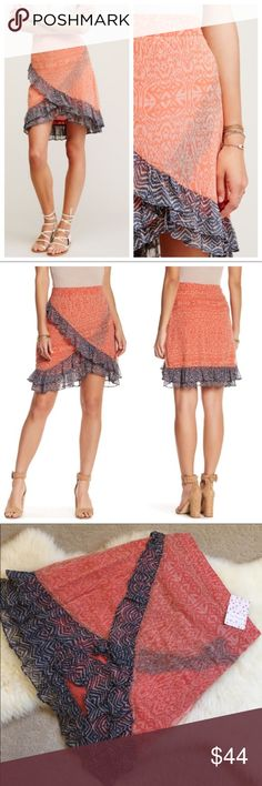 """Free People Ruffle Trimmed Hi-Low Skirt New With Tags- feminine and ultra flattering Free People skirt with hidden side zip closure, ruffled trim, allover print and high low hem. 100% Rayon. Waist 29.5"""", Length 14"""" At its shortest 21"""" at its longest. Free People Skirts High Low"""