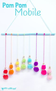 DIY RAINBOW POM POM MOBILE - brighten up your baby nursery, kids bedrooms or add a splash of colour to your living area with this cute and easy pom pom craft. A super way to use up yarn scraps. Easy Yarn Crafts, Yarn Crafts For Kids, Pom Pom Crafts, Craft Projects For Kids, Craft Activities For Kids, Diy For Kids, Arts And Crafts, Rainbow Activities, Art Projects