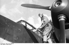 German pilot Oberleutnant Theodor Rossiwall preparing to enter his Bf 110 fighter, western France, summer 1940