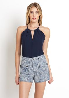 This looks similar to the t-shirt halter that I made - might give this a try....