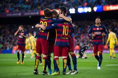 Players of FC Barcelona congratulate Lionel Messi after scoring the opening goal during the La Liga match between FC Barcelona and Sporting Gijon at Camp Nou on April 23, 2016 in Barcelona