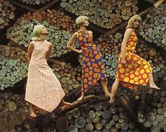 Marimekko. Models pose on stacks of wood for a life magazine photo shoot.