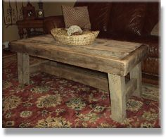barn wood coffee table over red and gold rug