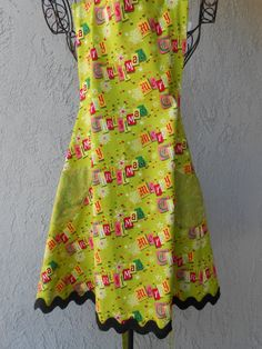 """Apron ads to the festivities """"Merry Christmas"""" with the greatest green reversible with pockets"""