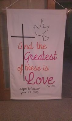 Church wedding banner. White with pink and orange lettering.