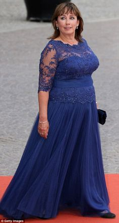 Mother of the bride Sofia Hellqvist wore a sweeping royal blue gown...