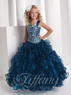 Girls Pageant Dress by Tiffany Princess 13332. Beautiful one shoulder neckline with unbeaded strap. Bodice features elegant embroidery.