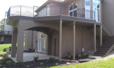 A large deck with covered area underneath.