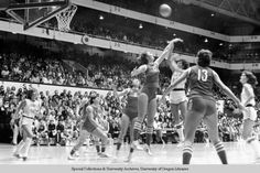 Black and white photo of an unidentified University of Oregon basketball player taking a jump shot against the Soviet Union's national team during a game played at McArthur Court on December 3, 1979. The Soviets defeated the Ducks 131-53 in the game. ©University of Oregon Libraries - Special Collections and University Archives