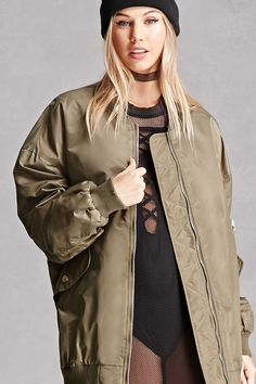 A lightweight woven bomber featuring a longline silhouette, distressing along the ribbed trim, a zippered front, dropped long sleeves, an on-sleeve zipper pocket, buttoned flap pockets, and a contrast quilted lining. This is an independent brand and not a Forever 21 branded item.