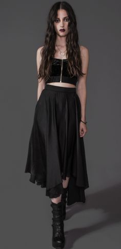All black everything. Bandeau + long, witch-y skirt, combat boots. Could be grunge, could be goth. I like.