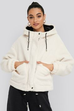 This jacket features a drawstring hood, a teddy material, a hidden zipper down the front, two pockets and long sleeves with elasticized cuffs. Jean Outfits, Hoods, Hooded Jacket, Trousers, Zipper, Legs, Long Sleeve, Sleeves, Sweaters