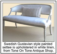 Fell in love with this white linen Swedish settee From Tone On Tone Antiques. The curved backrest and cut outs are delicate and a perfect backing for the detailed embroidered and pearl decorated lumbar pillow. The frame includes laurel leaf trim, applied lion masks & flowerettes, front turned fluted legs & rear sabering legs. #swedish_gustavian_style_decor