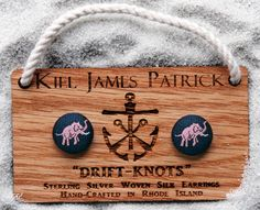 """I couldn't help it; I had to pin the elephants, too!  Kiel James Patrick """"drift-knots"""" earrings in Lennie (navy background with pink elephant) $22"""