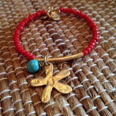 Red beaded bangle w/ flower charm Red beaded bangle bracelet with flower charm. toggle clasp. Accessorizit Jewelry Bracelets